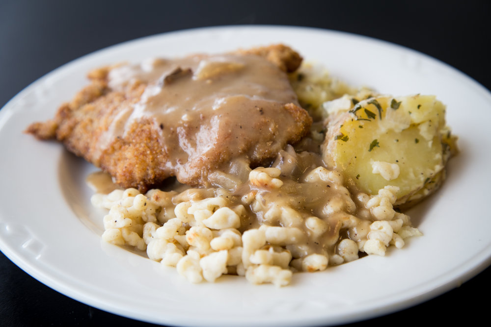 Pork Schnitzel with spaetzle made from scratch and potato salad.