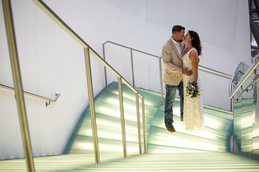 Taubman-Art-Museum-wedding-pictures-stairs-railings-couple-love-light-up-underlit