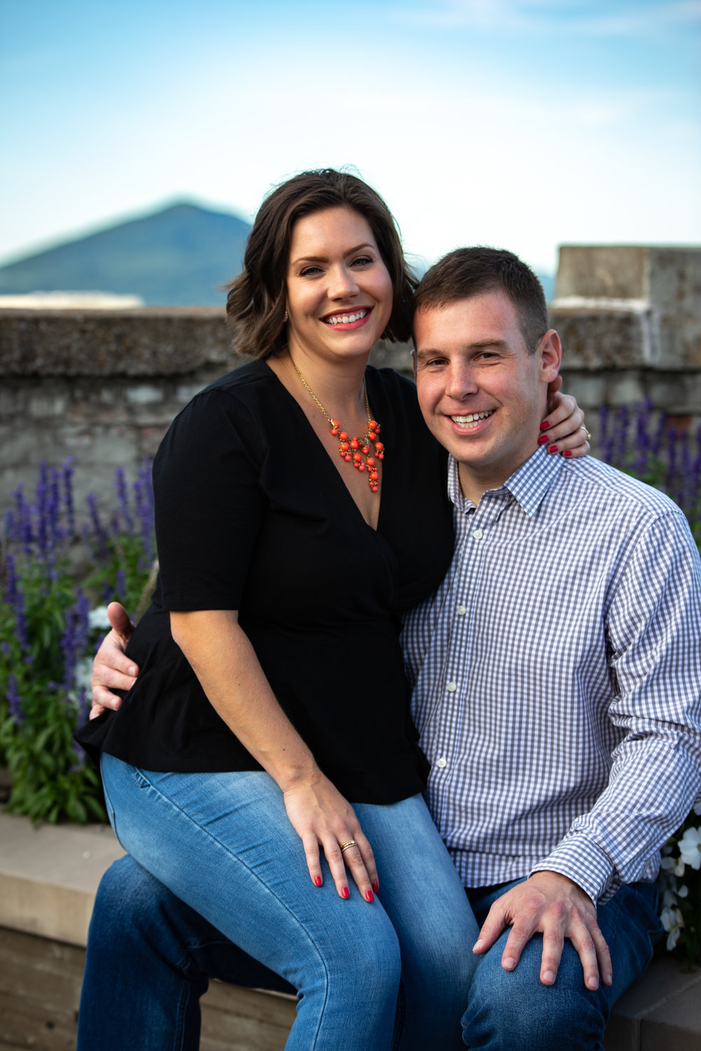 center-in-the-square-downtown-roanoke-urban-rooftop-engagment-wedding-love-couple-mountain-smile-laughing-flower-bed-concrete