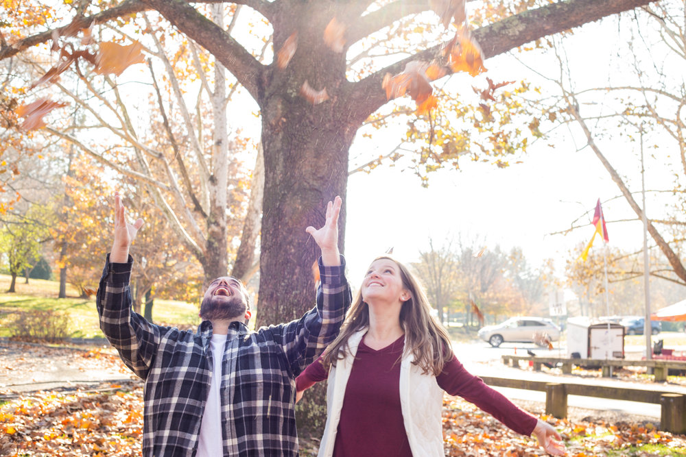 Fall-leaves-whimsy-love-couple-engagement-engaged-blacksburg-roanoke-virgina-tech-duck-pond-throw-sun