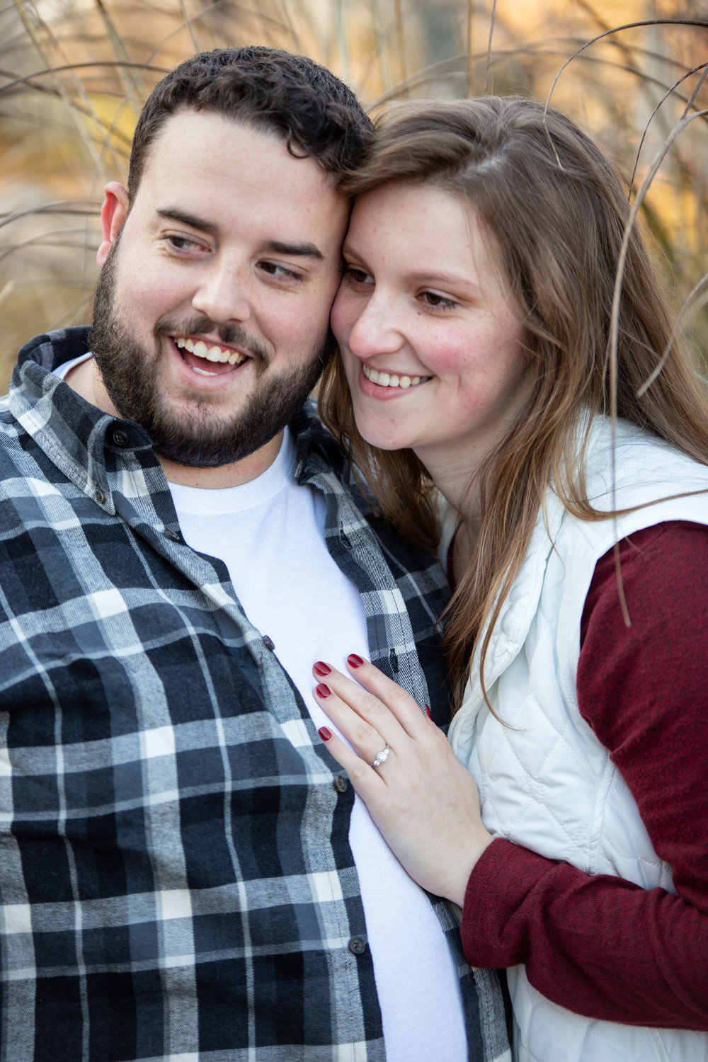 Fall-Laughing-together-bench-trees-duck-pond-virginia-tech-blacksburg-roanoke-engaged-warm