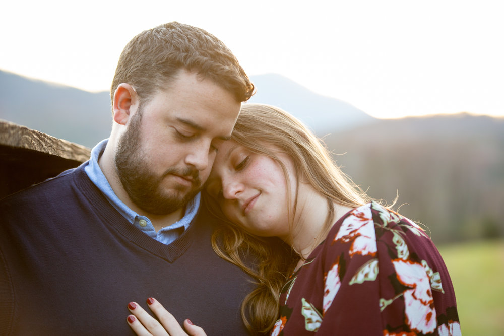 Blue-Ridge-Parkway-Fall-Sunset-couple-engaged-mountains-love-together-fence-roanoke-engaged-beauty-virginia-photography-nature-candid-head-rest
