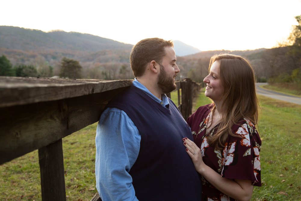 Blue-Ridge-Parkway-Fall-Sunset-couple-engaged-mountains-love-together-fence-roanoke-engaged-beauty-virginia-photography-nature-candid-each-other
