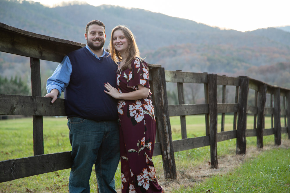 Blue-Ridge-Parkway-Fall-Sunset-couple-engaged-mountains-love-together-fence-roanoke-engaged-beauty-virginia-photography-nature-candid-wide