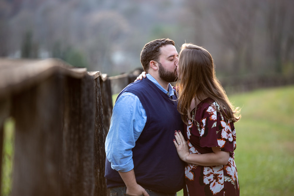 Blue-Ridge-Parkway-Fall-Sunset-couple-engaged-mountains-love-together-fence-roanoke-engaged-beauty-virginia-photography-nature-candid-kissing