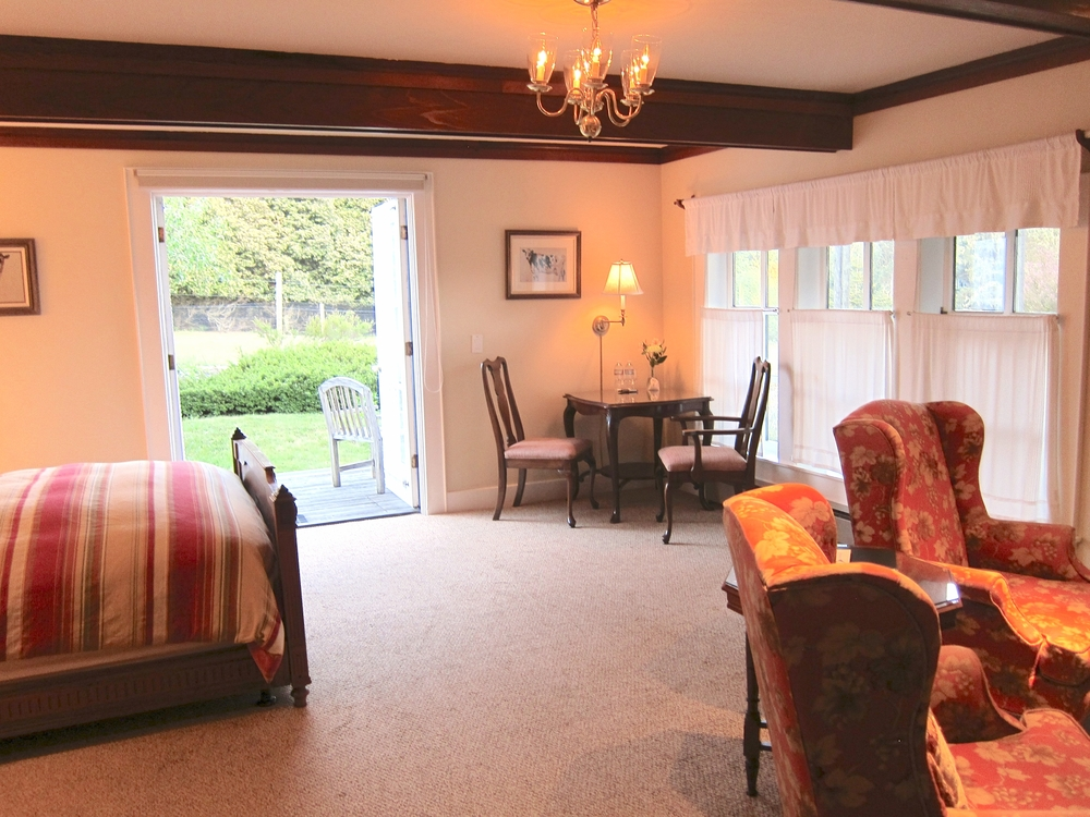 The East Farmington room at Glendeven Inn Mendocino has a private porch overlooking gardens, llama pastures and an ocean view