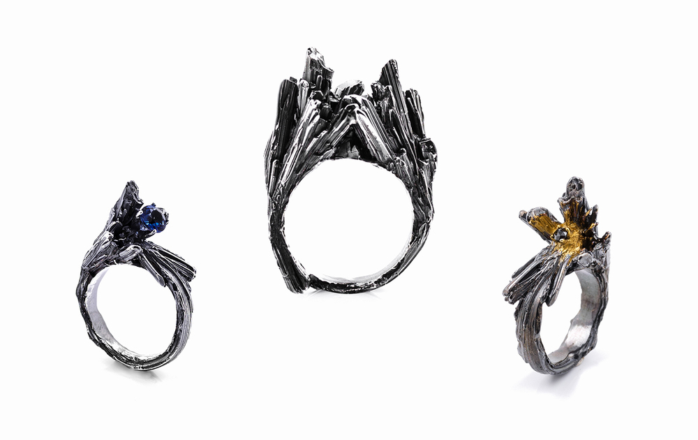Namazu Rings  designed to resemble collision boundaries between tectonic plates, pushing upwards and carrying with them precious stones.Left | Sterling silver, topaz, patina, 2015 |  Centre  | Sterling silver, patina, 2015 | Right  | Sterling silver, black diamond, gold vermeil, patina, 2015