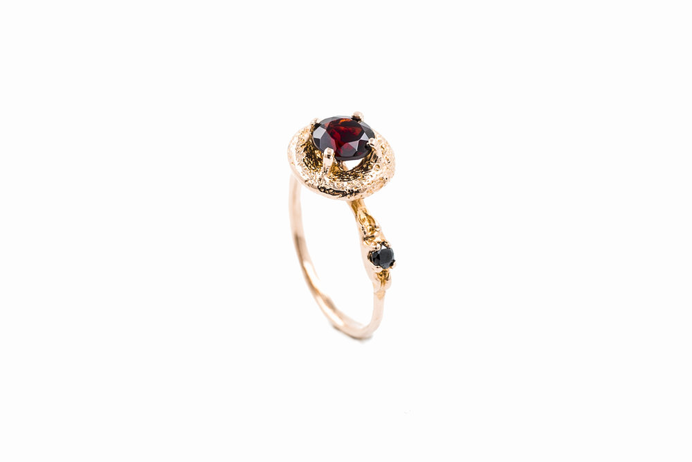 Surfacing Ring18ct rose gold + garnet + black diamond