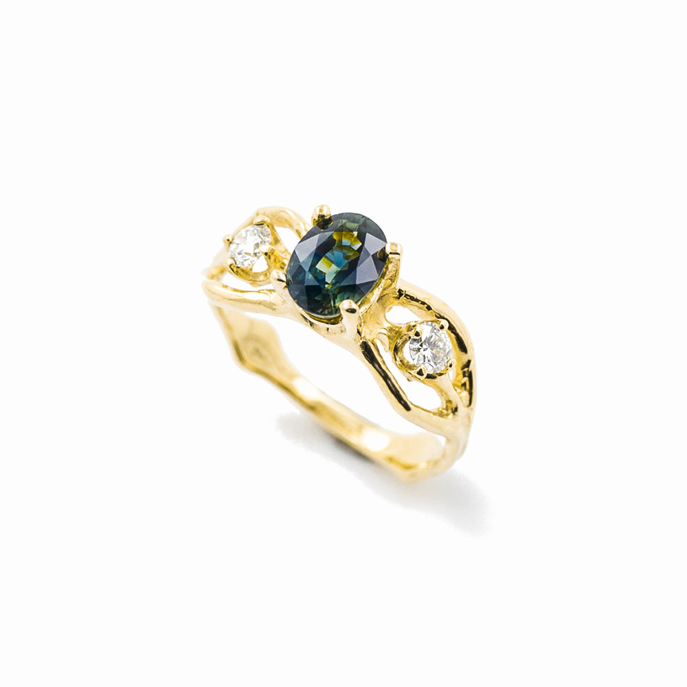 Unfolding Engagement Ring18ct yellow gold, sapphire, white diamonds