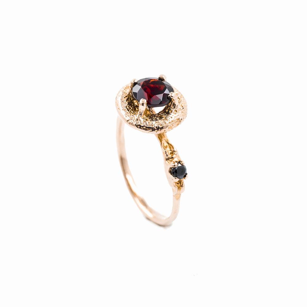 Surfacing Ring18ct rose gold,garnet, black diamond