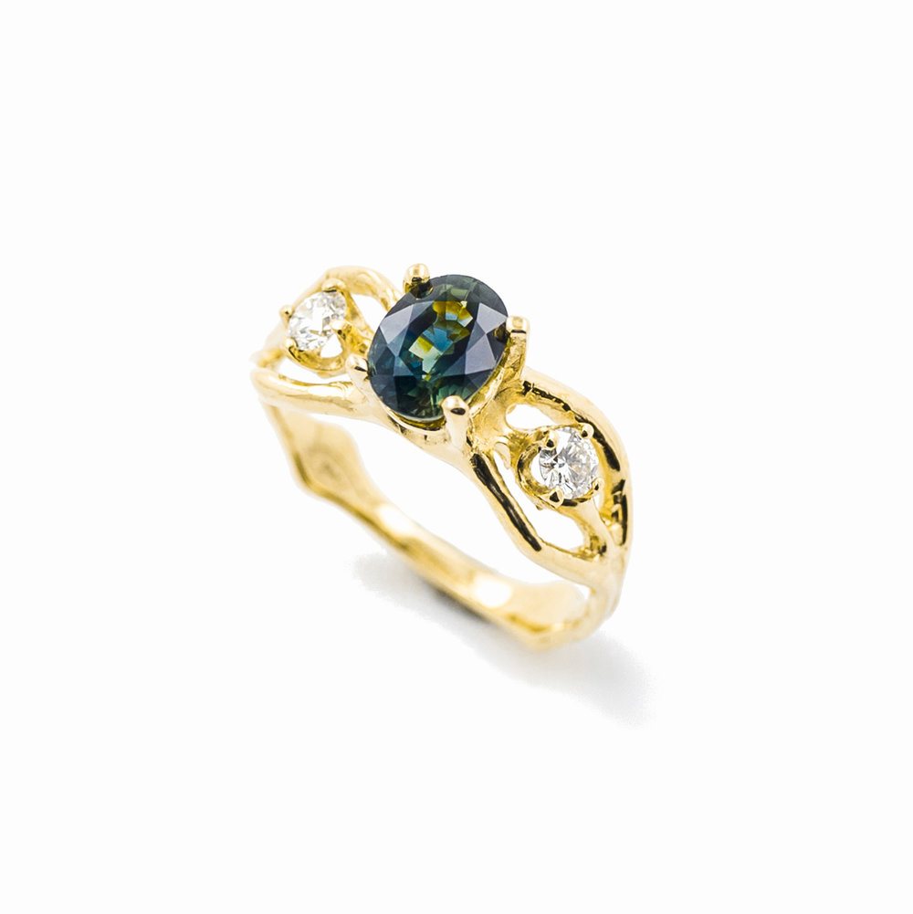 18ct yellow gold engagement ring with blue green sapphire and white diamonds