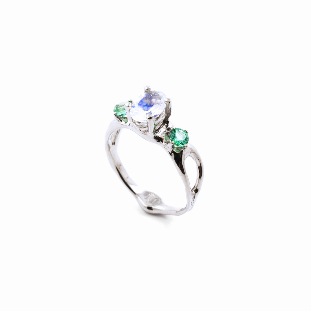 Unfolding Ring14ct white gold, moonstone, emeralds