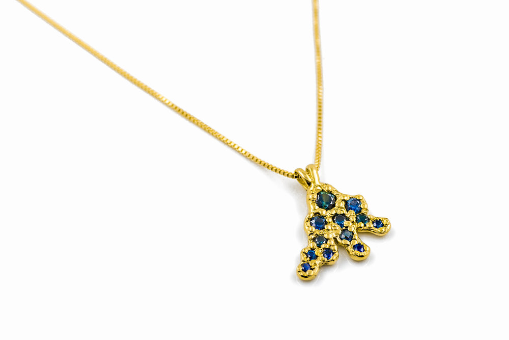 Beneath the Surface pendant | 18ct yellow gold, Australian blue and parti sapphires.