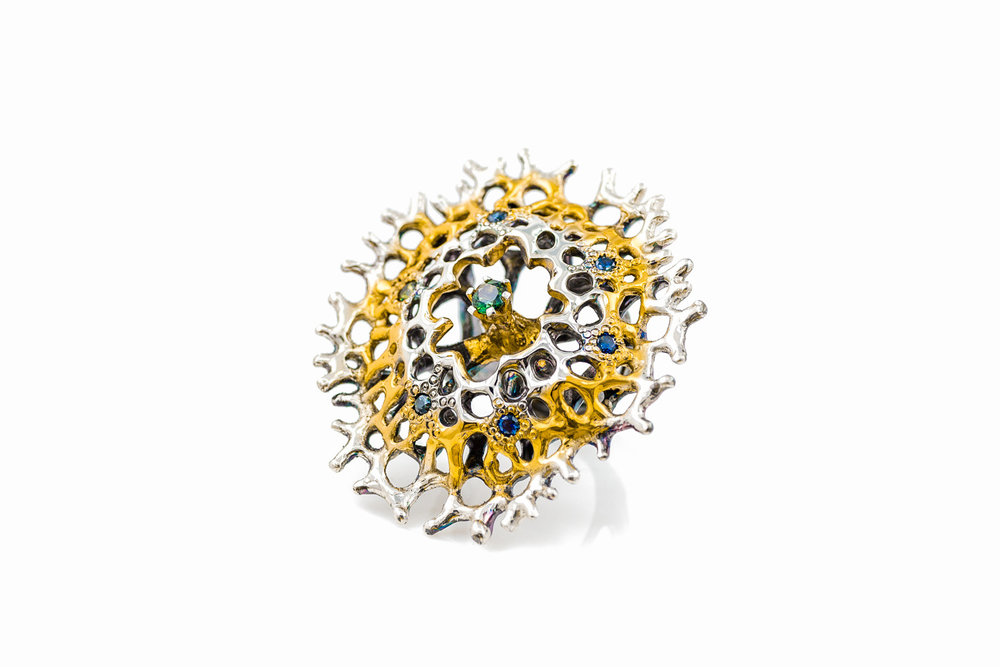 """ Enclosed Radial "" ring. Sterling silver, Australian sapphires, gold vermeil, patina."