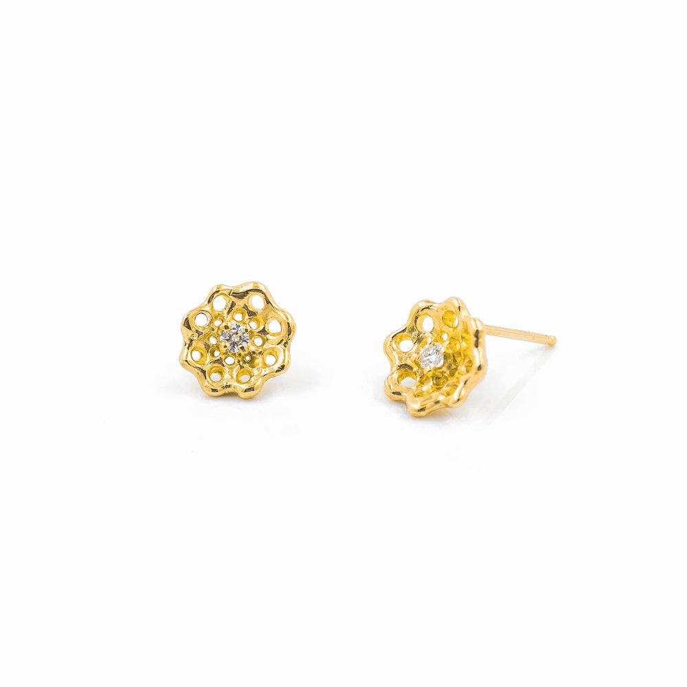 Cusp Earrings: Yellow gold and white diamonds.