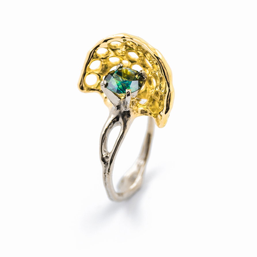 Australian parti sapphire surrounded by a veil of 18ct yellow gold and set in white gold. Created by Australian contemporary jeweller and neuroscience imaging specailist Luke Maninov Hammond for Beneath the Surface at Pieces of Eight