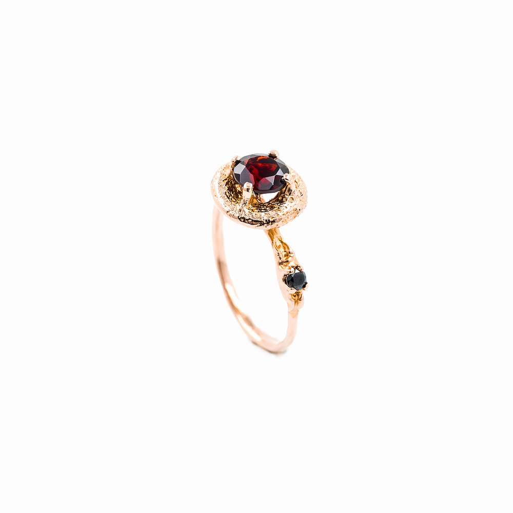 Surfacing Ring | 18ct rose gold, garnet, black diamond.