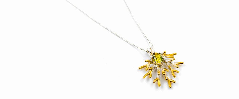 Unfolding Pendant | Sterling silver, yellow green Australian sapphire.