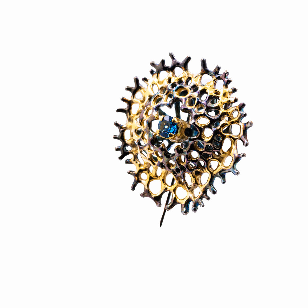 Enclosed Radial Brooch | Sterling silver, topaz, gold vermeil, patina.