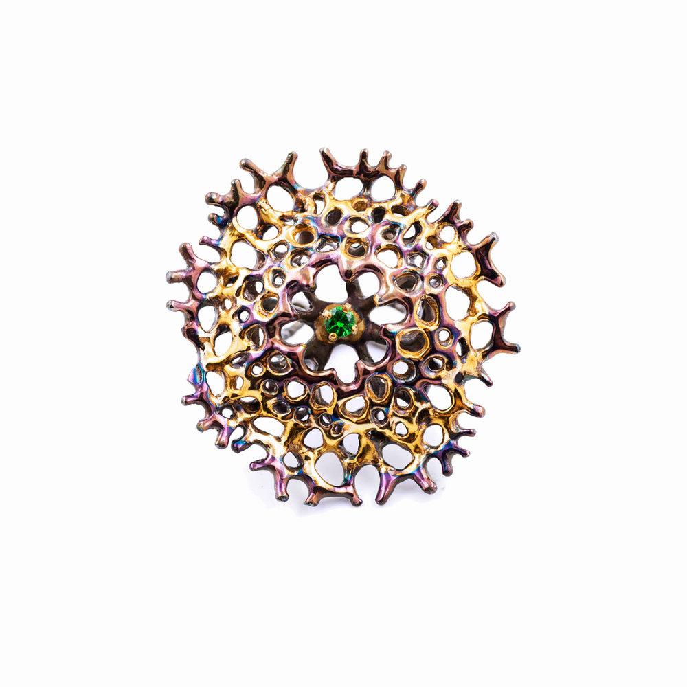 Enclosed Radial Ring | Sterling silver, tsavorite garnet.