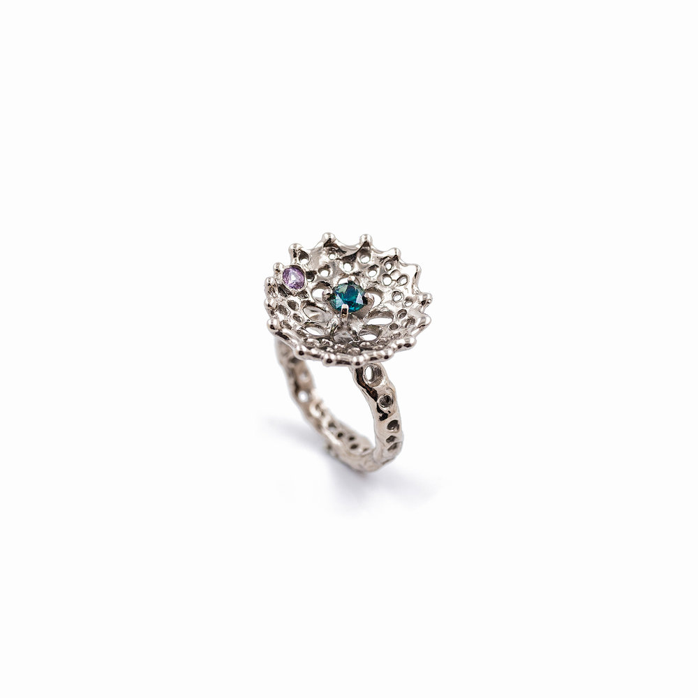 Radial Ring: An organic radial patterned ring of 18ct white gold holds a centrally set Australian blue sapphire and pink sapphire accent.