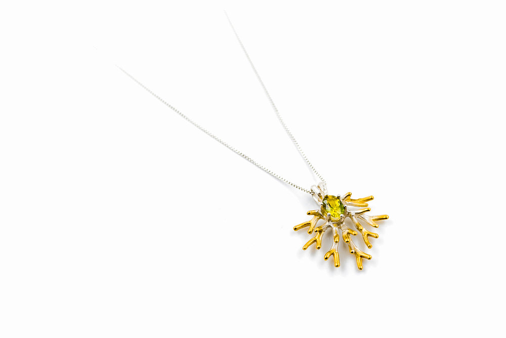 Unfolding pendant with carefully selective oval cut Australian yellow-green parti sapphire.