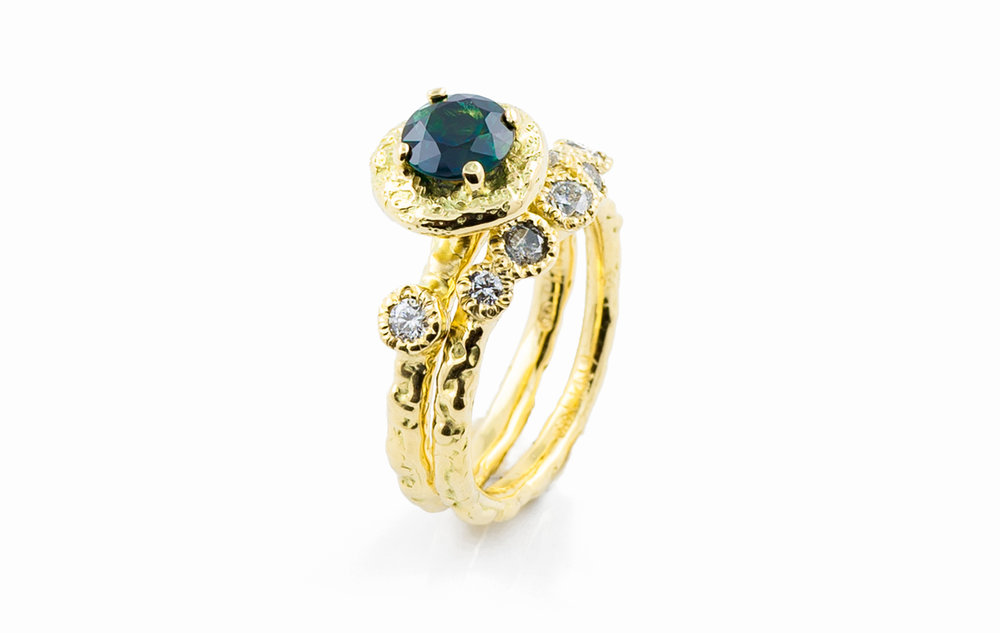 Surfacing Wedding and Engagement Ring | 18ct yellow gold, Australian sapphire, salt and pepper diamonds, white diamonds.
