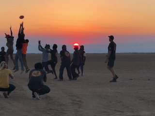 Aboriginal Rangers enjoying some downtime playing a game of footy and catching up with family and friends