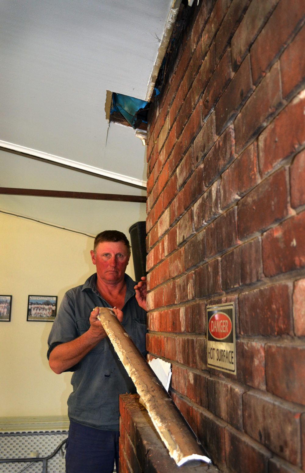 Falling apart: Yarroweyah Football Club member Bill Jones finds part of the ceiling at the club rooms collapsing from white ant damage. Picture: Toni Brient.
