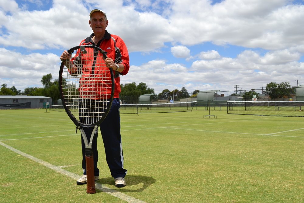 Causing a racquet: Cobram Lawn Tennis Club's beloved retiring coach Peter Morgan with the racquet he used to play in the Qantas Pro Ams competition in the 1980s. Picture: Toni Brient.