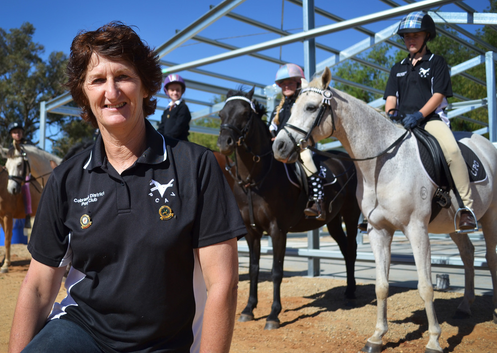 Nearly ready: Cobram Pony Club president Barb Clarke and riding students in front of club's new shed. Picture: Toni Brient.