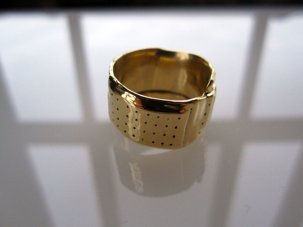 Wrapped Goldfinger    Ring Mini I , size 7, limited edition, designed to wear conventionally for a size 7 women's finger  / Polished 14 Karat Yellow Gold  Please refer to following gold image, which is another angle of the same ring.