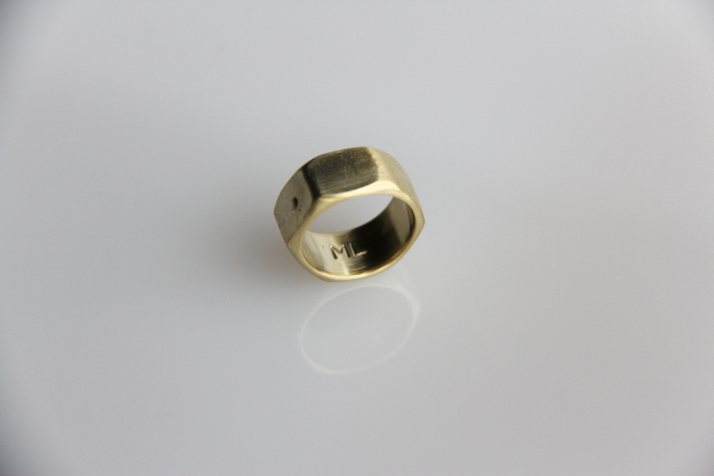 "Brass Nut Ring   The inspiration for this ring was an industrial nut and bolt. Itsdesign combines an industrial nut with the ""brass knuckle"" weapon into one single ring band. As a wedding band or symbolic love ring, it playfully bolts you to one another—gently and powerfully all at once.  When choosing sizing, select a half size up. So if you are a size 6, then order a 6.5 ring  Matte Yellow Brass"