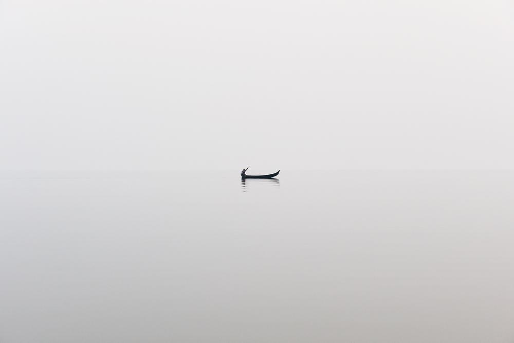 Fisherman in the mist  Indawgyi lake, Burma