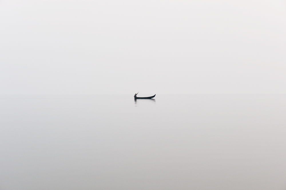 Fisherman in the mist, Indawgyi lake, Burma