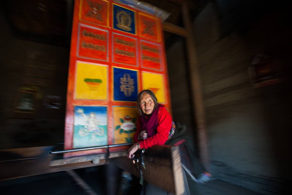 China   A Tibetan woman sends her prayers spiraling up to heaven