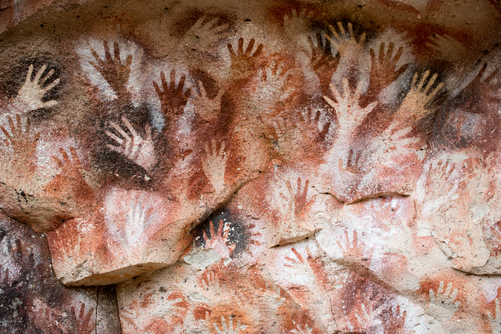 Argentina Cueva de las Manos is a cave or a series of caves located in the province of Santa Cruz, Argentina, 163 km south of the town of Perito Moreno. It is famous for the paintings of hands. The art in the cave dates from 13,000 to 9,000 years ago.