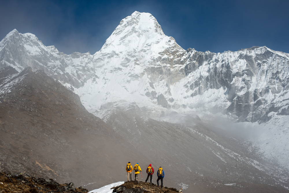 Nepal A team of climbers gaze up at the prospect ahead; Ama Dablam in the Khumbu region of Nepal