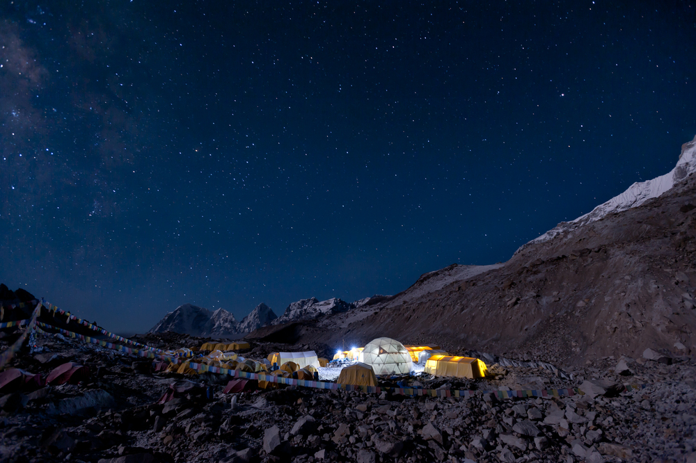 Nepal Climbers prepare to leave Everest base camp in the middle of the night for their summit attempt. The Milky Way is visible above the Khumbu glacier.