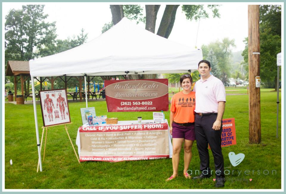Jen and her husband at their company tent!