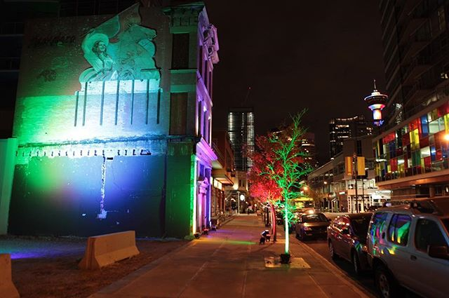 That one time we lit up the Mescalero Building on 1st Street… If there's one thing we love, it's using lights to activate different spaces in #VicParkYYC. We've tried this on a few spaces, and the result is always fun. #vicparkyyc #yyv #yycliving #yycevents #tbt #throwbackfriday