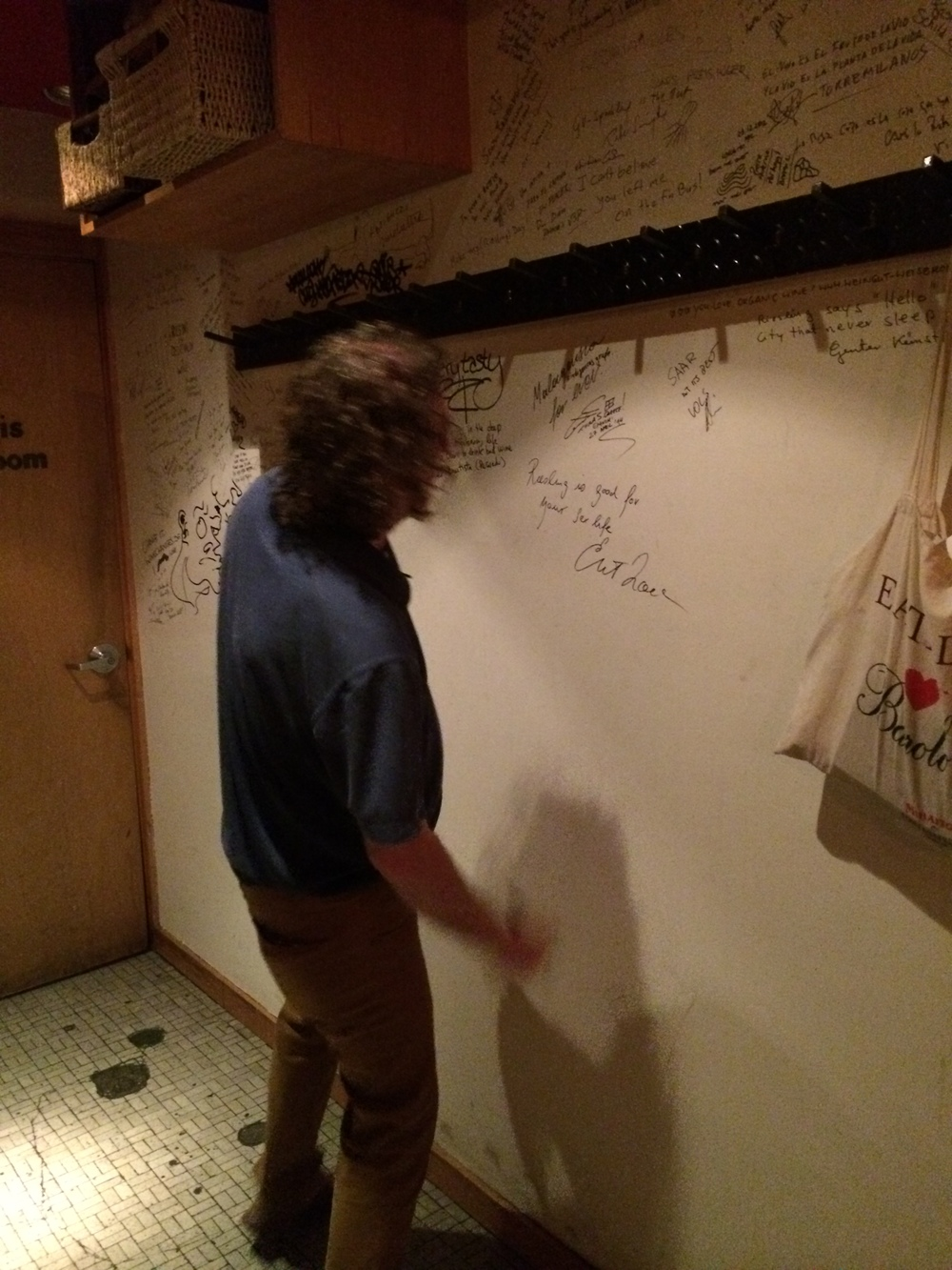 Ernie Signs the Wall