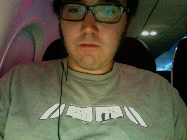 Snakes on a Plane  on a T-Shirt on a plane.   IS THAT ENOUGH FUCKING MEMES FOR YOU, INTERNET?