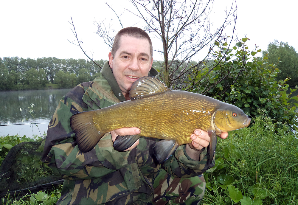 A welcome sight, not that he looks that happy... that's the tench, not Gary!