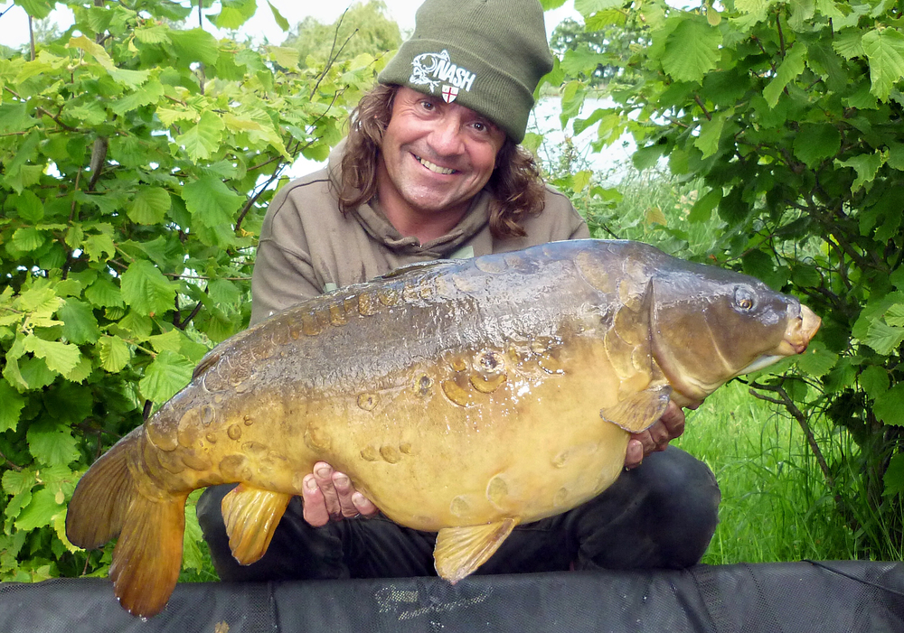 The man himself, Julian Cundiff in familiar pose with yet another carp!