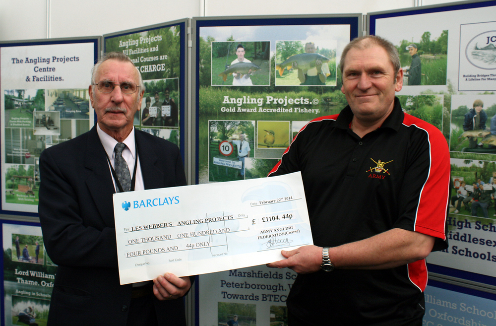 Les receives a cheque from Lt Col Keith Armstrong at this year's Carpin' On show