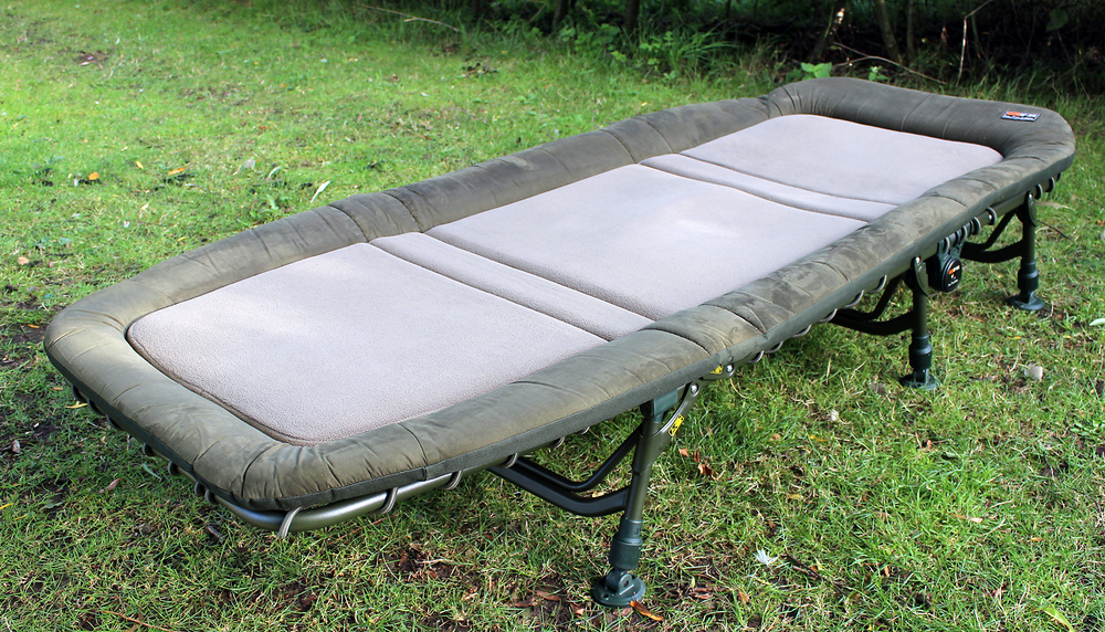 With a full width level sleeping area the Flatliner   ®    is topped by a thick mattress