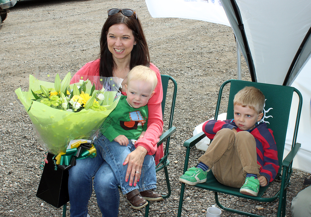 Jo Green is presented with a beautiful bouquet, not that her boys seem that impressed!