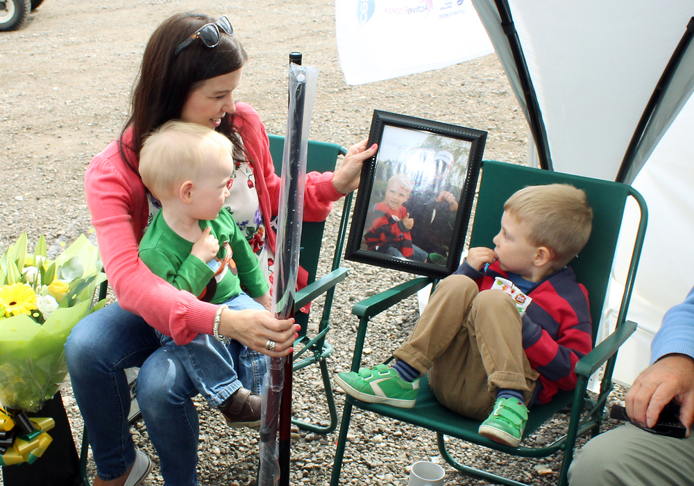 Jo is given a framed photo of young Reuben catching his first ever fish