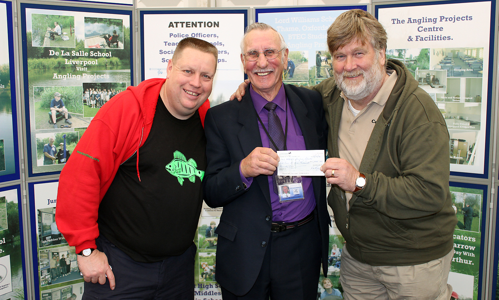 Paul Thompson (left) and Des Taylor (right) present Les Webber with a cheque at this year's Big One Show